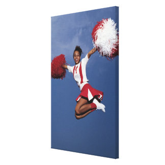 Cheerleader in mid-air canvas print