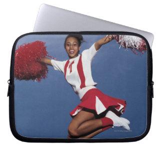 Cheerleader in mid-air laptop sleeves