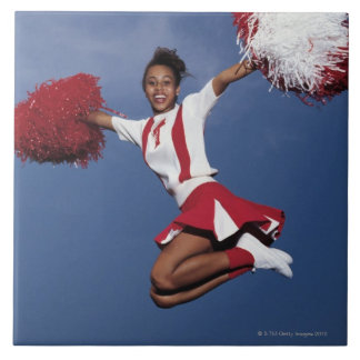 Cheerleader in mid-air large square tile