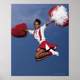Cheerleader in mid-air poster