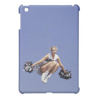 Cheerleader jumping, low angle view, portrait cover for the iPad mini