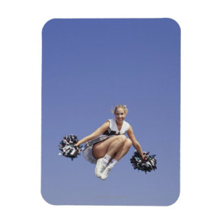Cheerleader jumping, low angle view, portrait rectangular photo magnet