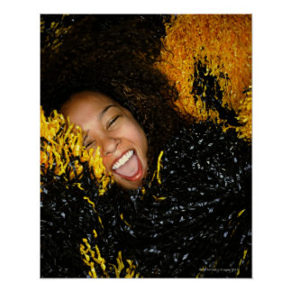 Cheerleader laughing, surrounded by pompoms, poster
