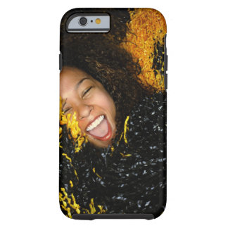 Cheerleader laughing, surrounded by pompoms, tough iPhone 6 case