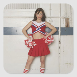Cheerleader standing on bench near basketballs, square sticker