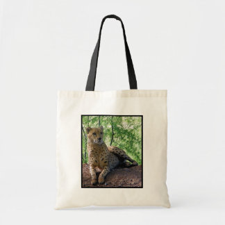 Cheetah on a rock tote bag