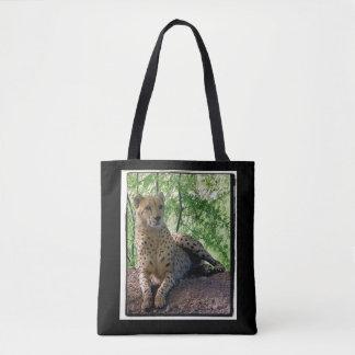 Cheetah on a rock tote bag