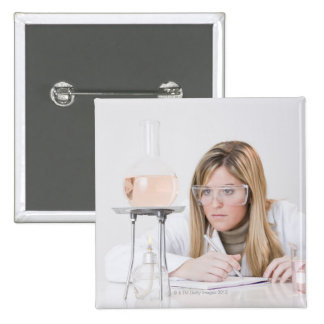 Chemist looking at Bunsen burner 15 Cm Square Badge
