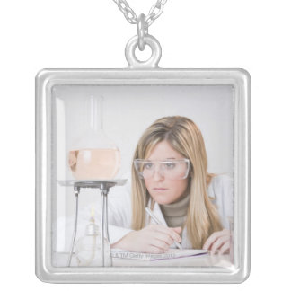 Chemist looking at Bunsen burner Silver Plated Necklace