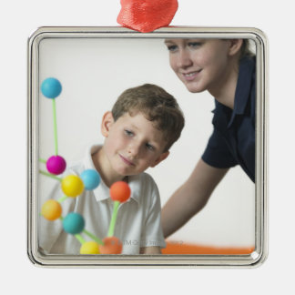 Chemistry lesson. 6 year old boy and his teacher Silver-Colored square decoration