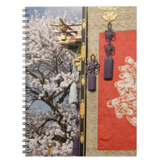 Cherry blossom tree and silk tapestry of notebooks