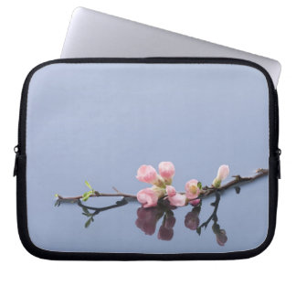 Cherry blossoms on water laptop computer sleeves
