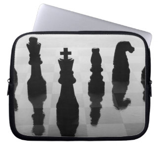 Chess pieces on chess board in black and white laptop sleeve