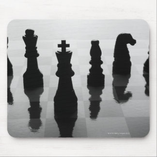 Chess pieces on chess board in black and white mouse mat