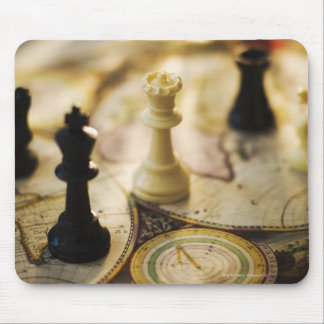 Chess pieces on old world map mouse mat