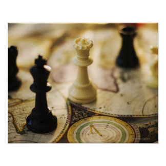 Chess pieces on old world map poster