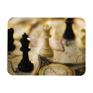 Chess pieces on old world map vinyl magnets