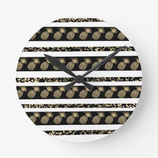 Chic black and gold confetti pineapple stripes round clock