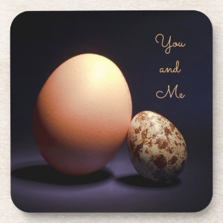 Chicken and quail eggs in love. Text «You and Me». Coaster