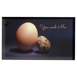 Chicken and quail eggs in love. Text «You and Me». Table Number Holder