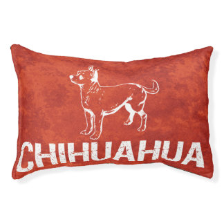 Chihuahua dog on red artistic pet bed