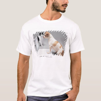 Chihuahua looking into the screen of a laptop T-Shirt