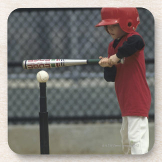 Child batting a tee ball coaster