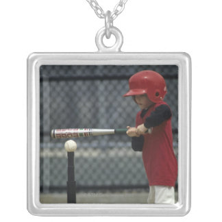 Child batting a tee ball silver plated necklace