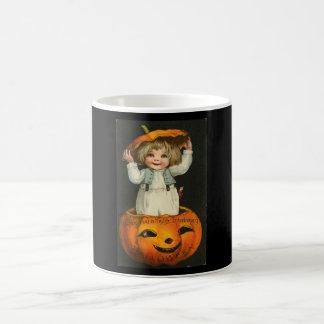 child in jackolantern coffee mugs