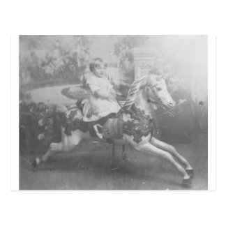 child on carousel horse postcard