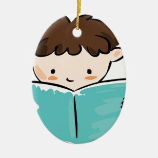 Child reading a book ceramic oval decoration