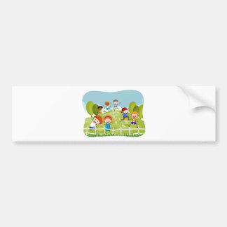 Children doing hopscotch in the park bumper sticker