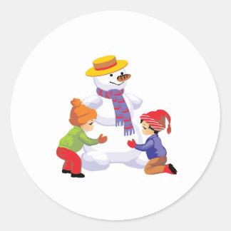 Children Making A Snowman Round Sticker