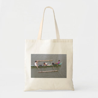 Children playing in a fishing boat canvas bag