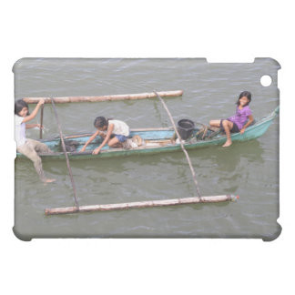 Children playing in a fishing boat iPad mini cover