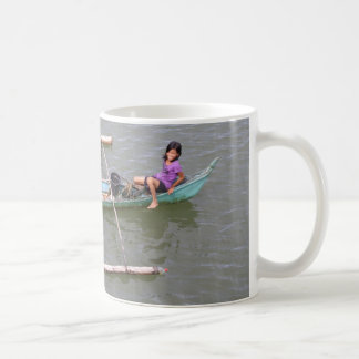 Children playing in a fishing boat coffee mugs