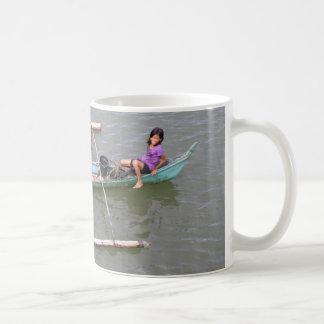 Children playing in a fishing boat coffee mugs