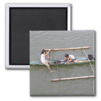 Children playing in a fishing boat square magnet