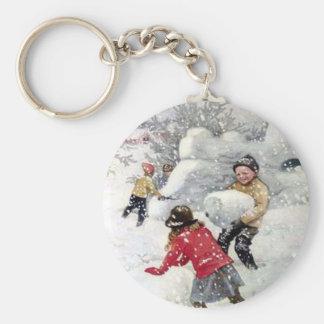 children playing in snow key ring