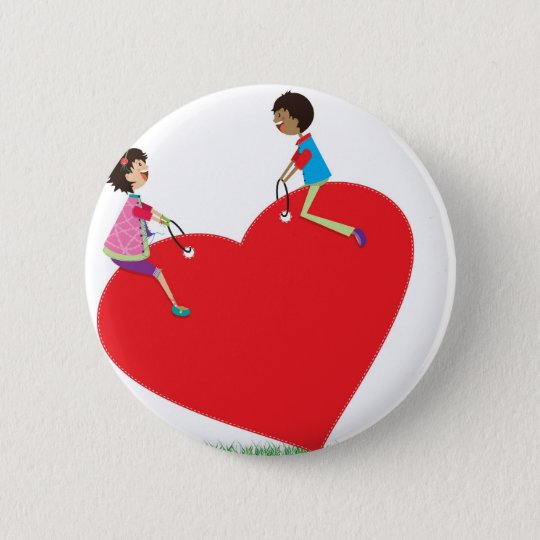 children playing on a heart shaped see-saw 6