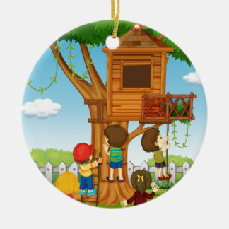 Children playing on the treehouse christmas ornament