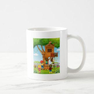 Children playing on the treehouse coffee mug