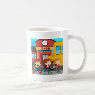 Children running in front of school basic white mug