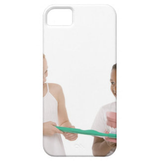 Children with a model set of teeth and oversized barely there iPhone 5 case