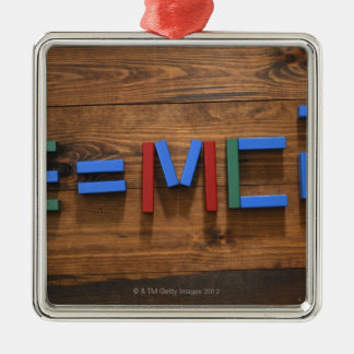 Child's building blocks arranged to show E=mc2 Silver-Colored Square Decoration