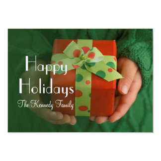 Child's hands holding a present card
