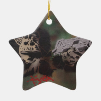 Chimp shooting ceramic star decoration