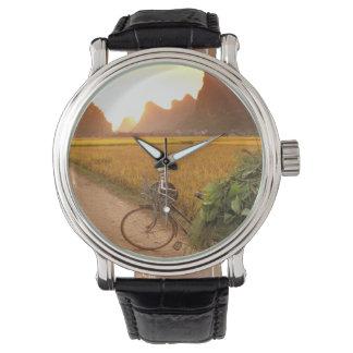 China, Guangxi. Yangzhou, Bicycle on country Wristwatch