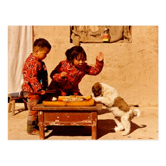 China in winter, Children playing with a dog