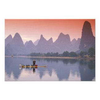China, Li River. Single cormorant fisherman. Art Photo
